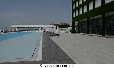 Panning the swimming pool at the modern luxury hotel,...