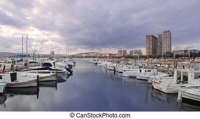 panning timelapse across the harbour in the coastal town of palamos, costa brava, spain