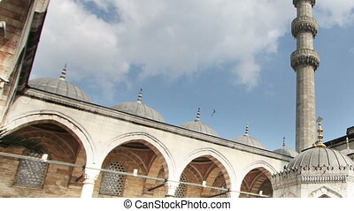 panning timelapse inside courtyard of the yeni cami mosque...