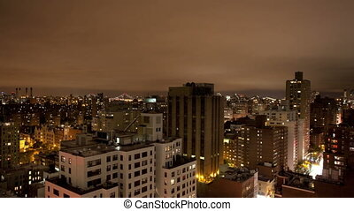 panning timelapse of manhattan skyline from a high vantage point at night