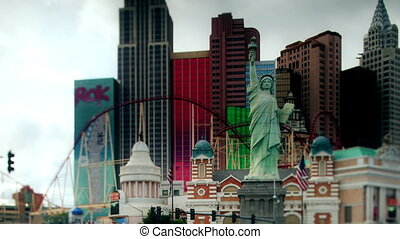 panning timelapse shot of the new york new york hotel/casino and the strip with traffic, las vegas, nevada