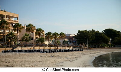 panning timelpase shot of beach at sunrise in mallorca,...