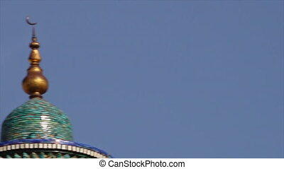 Panning to the top of a mosaic temple dome - A close-up...
