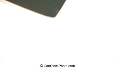 Panning vertically along an isolated Canadian passport -...