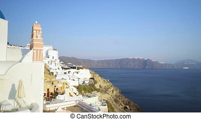 Panning view of blue dome churches and Caldera in Santorini...