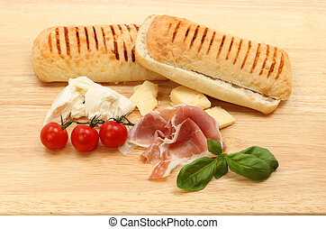 Pannini ingredients on a board