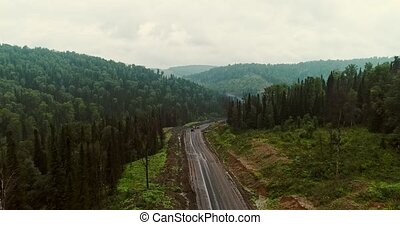 Panorama aerial view on road in forest. Aerial view of...