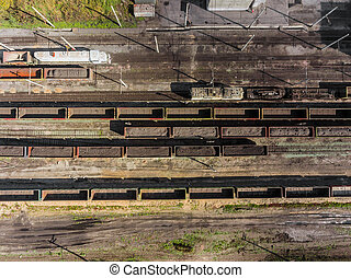 Panorama aerial view shot on railroad tracks with wagons laden Coal. Loading railway cars. Mining coal extractive industry anthracite factory