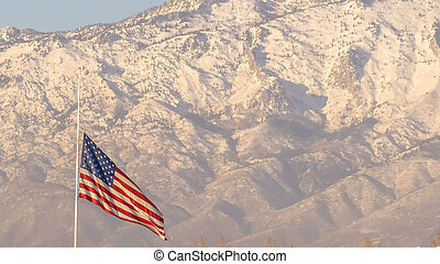 Panorama American flag and building with Mount Timpanogos and sky in the background