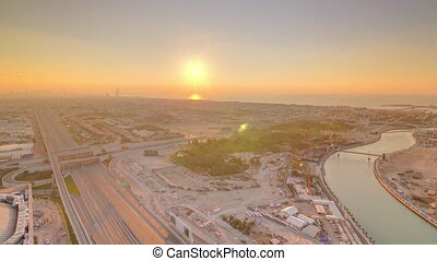 Panorama and aerial view of coastline Dubai at sunset...