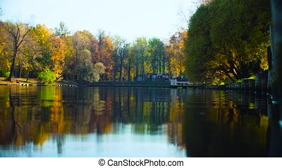 Autumn landscape, lake in the park, colorful leaves on trees
