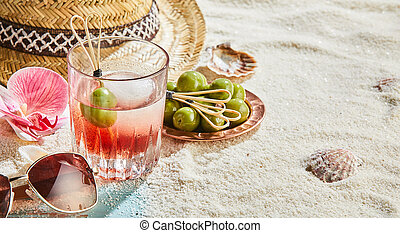Panorama banner of a cocktail on a tropical beach