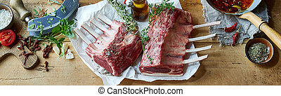 Panorama banner with two uncooked racks of lamb