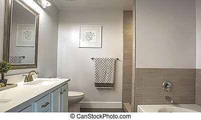 Panorama Bathroom interior with a bathtub in front of thee vanity area and mirror