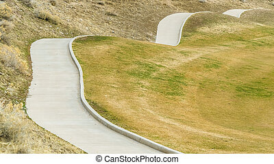 Panorama Close up of a paved pathway running through the slope of a mountain