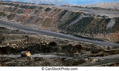 panorama coal cut rides truck - A panorama of the coal mine...