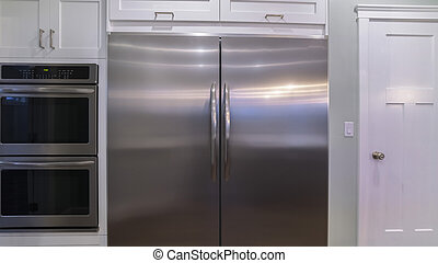 Panorama crop Large double door fridge with fitted ovens