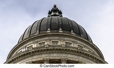 Panorama Dome and pediment of Utah State Capital building in Salt Lake City against sky