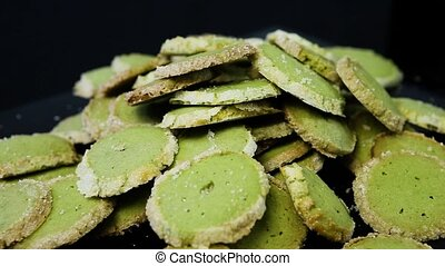 panorama down on batch of green shortbread cookies lie on a...
