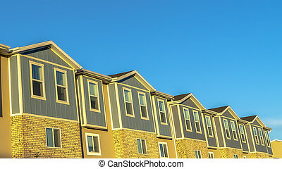 Panorama Facade of townhouses with clear blue sky background on a sunny day
