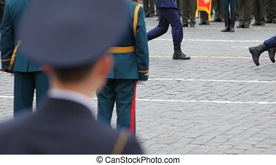 Panorama following legs soldiers march at military parade -...