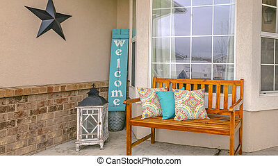 Panorama frame Facade of a home with a wooden bench on the welcoming front porch