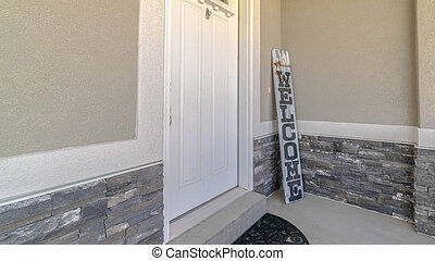 Panorama frame Front door and porch of home with welcome sign