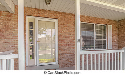 Panorama frame Front porch and door of traditional brick home