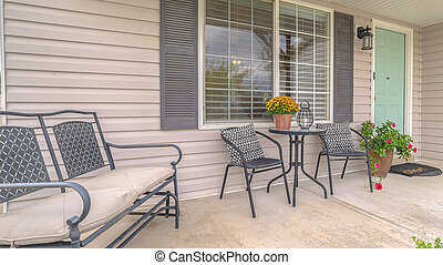 Panorama frame Front porch of modern home with outdoor furniture