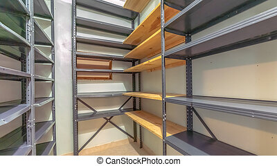 Panorama frame Interior of a small empty closet with metal and wood shelves for clothes