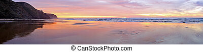 Panorama from a beautiful sunset at the atlantic ocean in Portugal