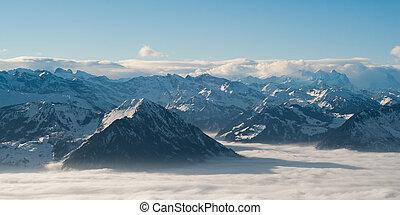 panoramic view of swiss alps from rigi mountain in witer, switzerland