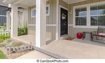 Panorama Front porch of modern home with welcome sign