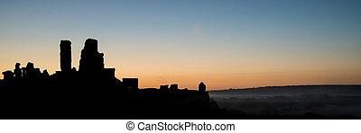 Panorama landscape medieval castle silhouette vibrant dawn sunrise