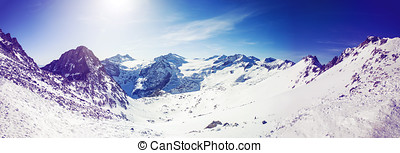 panorama landscape of alpine mountains on sunny winter day
