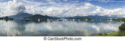 Panorama landscape photography, mountain, cloudscape, boats on lake