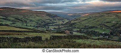 Panorama landscape sweeping countryside vista at sunset in Autumn