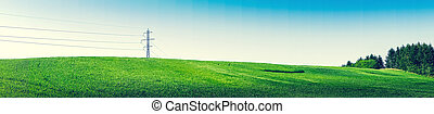 Panorama landscape with pylons and green trees