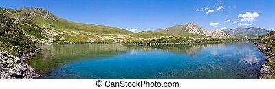 Panorama mountain lake in alps