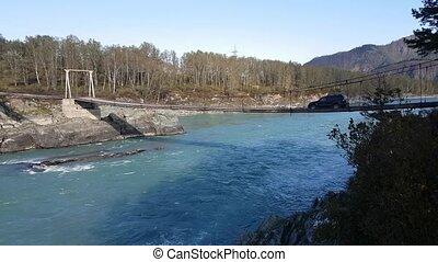 Panorama mountain river, hanging bridge, turquoise water, summer and autumn