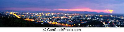 Panorama night city lights bokeh background