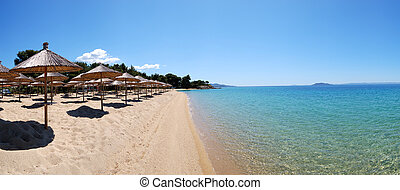 Panorama of a beach and turquoise water at the luxury hotel, Halkidiki, Greece