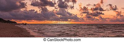 Panorama of a beach sunset over Baltic sea