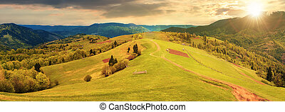 panorama of a countryside in mountains at sunset