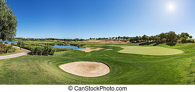 Panorama of a golf course sand trap.