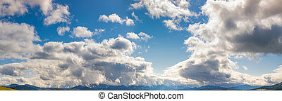 a gorgeous cloudscape above the mountain - panorama of a...