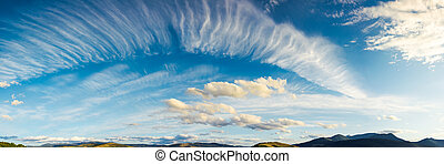 panorama of a gorgeous cloudscape. dynamic high cloud...