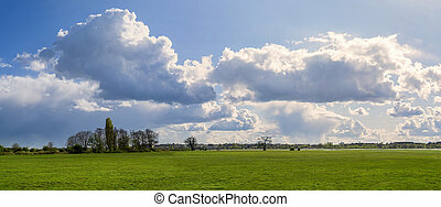 panorama of a landscape with beautiful cloudscape