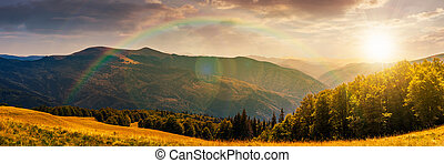 panorama of a mountainous landscape at sunset - panorama of...