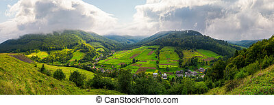 panorama of a rural area in mountains. gorgeous forenoon...